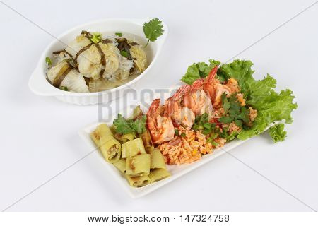 Fried rice with shrimp and grilled green sweet chili s with Streamed lettuce wrap minced pork soup on white background.  Side view.