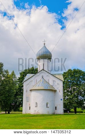 Architecture summer cloudy view of ancient church of Church of the Twelve Apostles on the Abyss in Veliky Novgorod Russia. Architecture view of landmark in summer sunny day