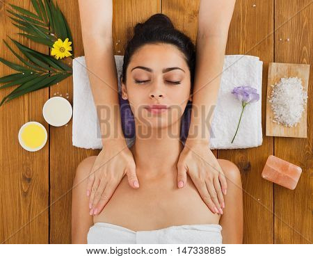 Massagist with woman patient in aroma spa wellness center. Professional face and body massage to beautiful girl in cosmetology cabinet or beauty parlor.