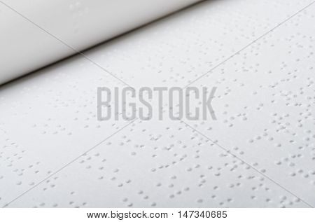 Close up of open book written in braille