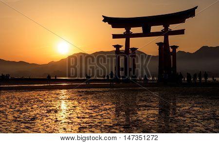 Silhouette of floating Torii Gate Miyajima island Hiroshima Japan