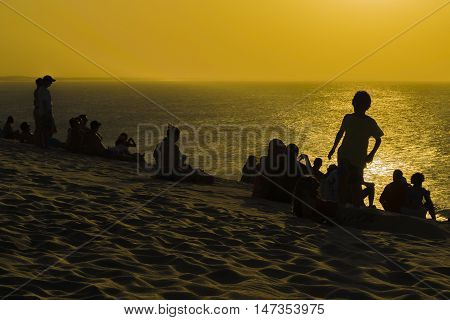 People at beach in the famous dune of Jericoacoara waiting to see the sunset