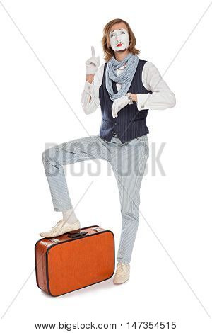 mime actor with orange suitcase remembered something glancing at his watch