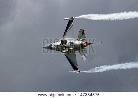 GILZE-RIJEN NETHERLANDS - JUNE 20 2014: Belgian Air Force F-16 solo display performing at the Dutch Air Force Open Day.
