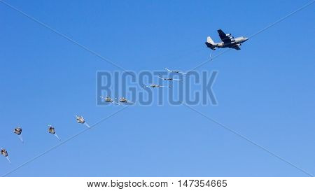 Paratrooper jumping out of a military transport plane.
