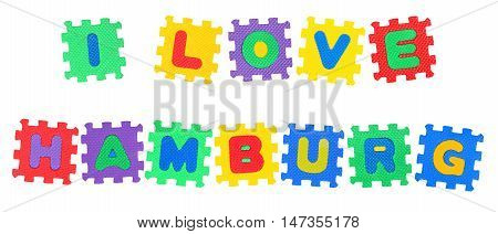 Message I Love Hamburg from letters puzzle isolated on white background.