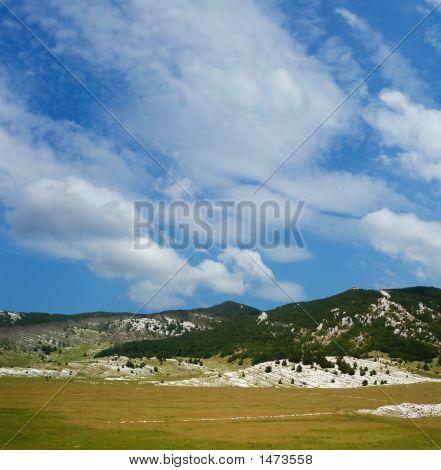 Dinara Mountain Over Blue Sky 10