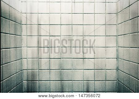 Dirty grain white marble tiles wall in bathroom for texture background