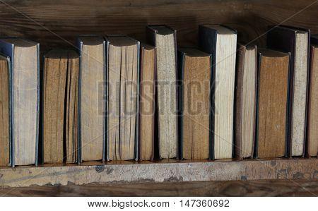 old books on wooden shelf.