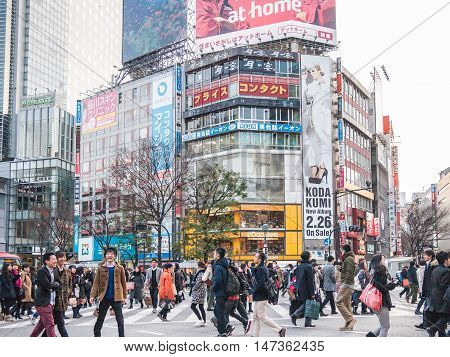 Tokyo, Japan - February 19 2014 - Shibuya Crossing One of the world's most crowded pedestrian crosses.