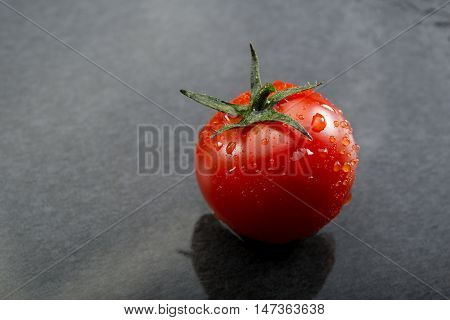 Cherry Tomatoes On Black Slate