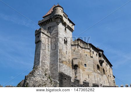 Ancient castle Liechtenstein donjon Vienna woods village Maria Enzersdorf Austria - against bright blue sky