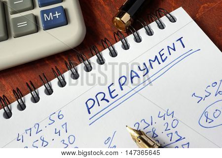 Notepad with prepayment on a wooden surface.
