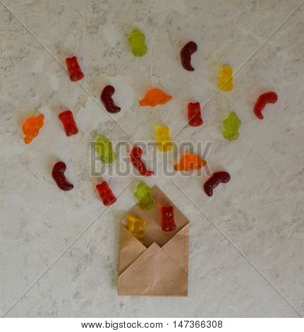 Colorful eat gummy bears jelly candy background. Bears in envelope