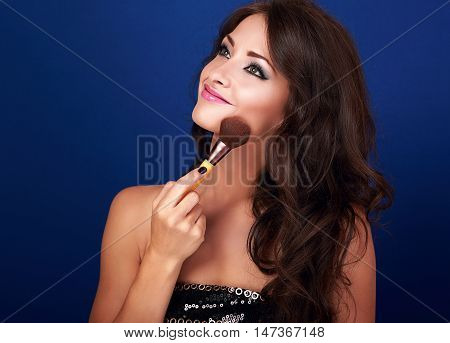 Beautiful Makeup Woman Applying Make-up Powder By The Brush On Clean Perfect Skin Face On Blue Backg