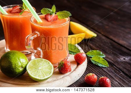 Smoothie With Mango, Strawberries And Lime