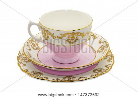 Antique fine china tea cup and small cake plate.