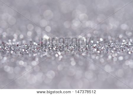 festive abstract glitter bokeh background, elegant silver holiday backdrop