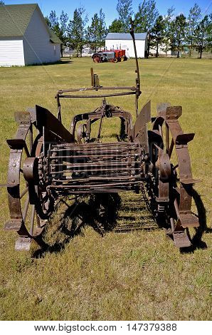 An old horse drawn potato picker used to dig the spuds out of the ground.