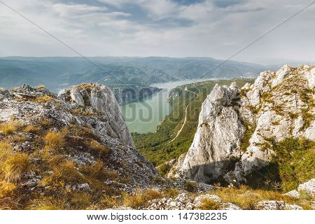 Danube river in Djerdap National park, Serbia.  Cliffs over Danube river, Djerdap National park, east Serbia. View from the top of the cliffs poster