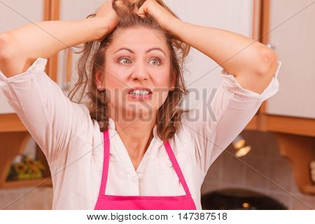 Unhappy Housewife In Kitchen