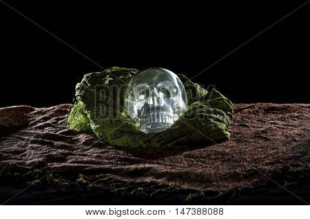 Mysterious glowing crystal skull on a black background