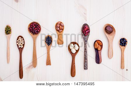 Assortment Of Beans And Lentils In Wooden Spoon Set Up On Wooden Background. Mung Bean,soybean, Red