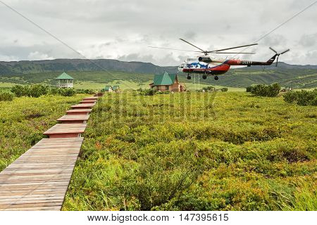 Kamchatka Peninsula, Russia - August 12, 2016: Helicopter landed in the Uzon Caldera. Kronotsky Nature Reserve on Kamchatka Peninsula.