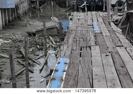 Old Wooden pier wooden bridge in evening. Select focus front wooden bridge with shallow depth of field : space for add text above and may be used as background :
