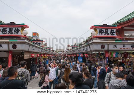 TOKYO  , JAPAN - MAY 2 , 2016:  Nakamise shopping street in Asakusa, Tokyo, Japan. MAY 2 2016. Walkway shopping road to Senso-ji Temple