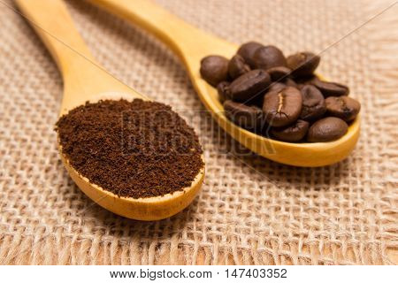 Ground Coffee And Grains With Wooden Spoon On Jute Canvas