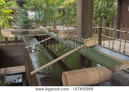 TOKYO  , JAPAN - MAY 2 , 2016 :  Water dippers at Ueno Park , Tokyo, Japan. MAY 2 2016. Water used for washing hands and mouth before into temple.