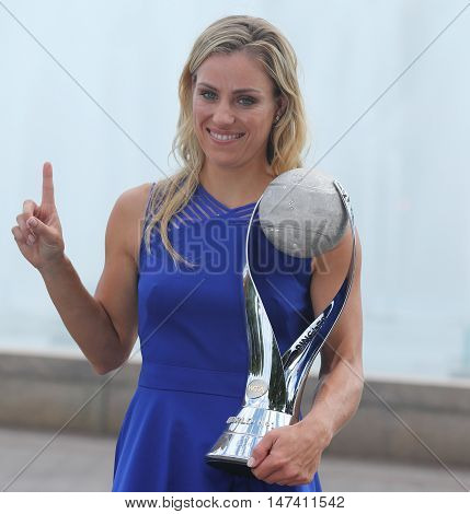 NEW YORK - SEPTEMBER 11, 2016: Two times Grand Slam champion Angelique Kerber of Germany poses with the WTA No.1 trophy after her victory at US Open 2016 at Billie Jean King National Tennis Center