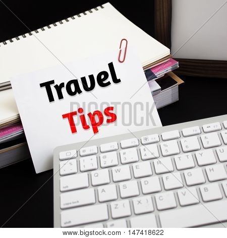 Word text Travel tips on white paper card / business concept
