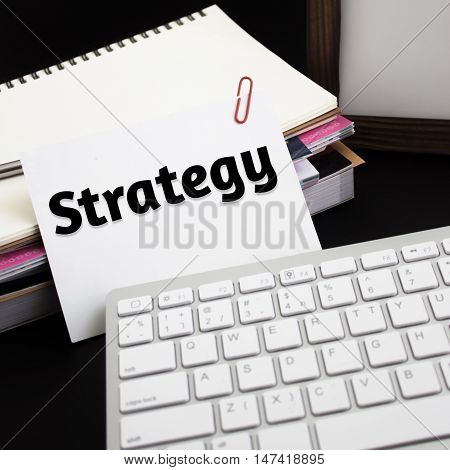 Word text Strategy Business on white paper card / business concept