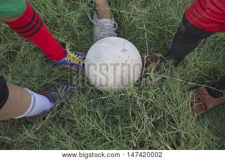 Training and football match between youth soccer teams. Young boys playing soccer game.