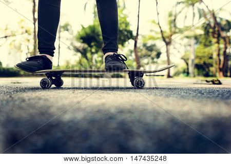 Young Woman Jumping Olly Skateboard Concept