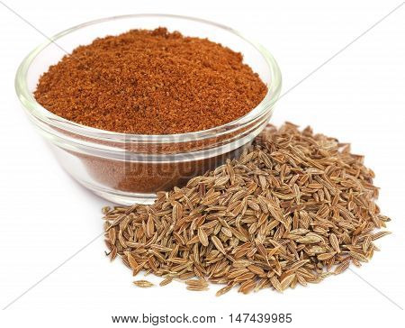 Crushed cumin in a bowl over white background
