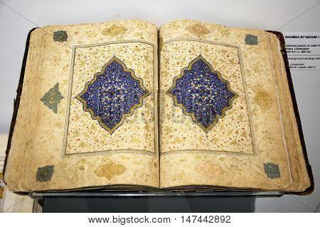 Kuala Lumpur, Malaysia - November 30, 2015. Khamsa book by Nizami on display at the Islamic Arts Museum in Kuala Lumpur. ca 1560 AD.