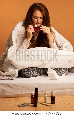 Illness Flu - Ill Woman Drink Tea In Bed