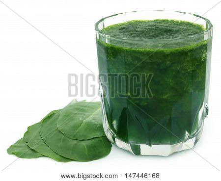 Fresh spinach with juice in a glass