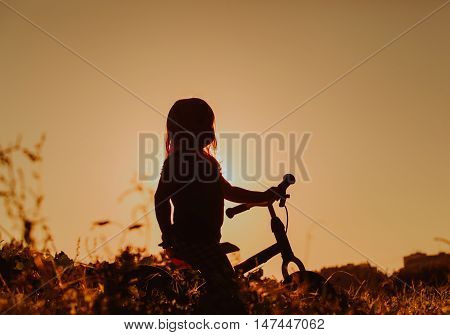 little girl riding bike at sunset, active kids sport