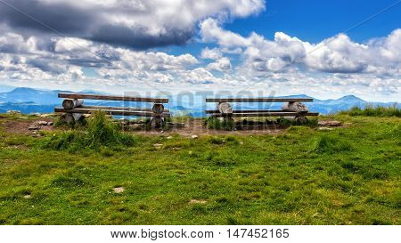 Wooden table and bench for relaxation on the top of Pip Ivan mountain nature landscape in Carpathians Ukraine