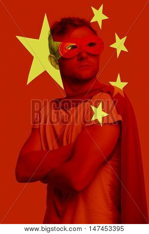 Superhero standing over Chinese flag