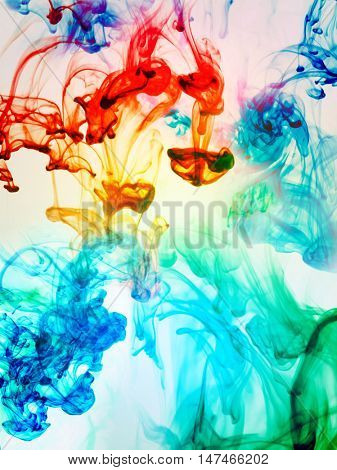 Multi-coloured substances dissolving in water
