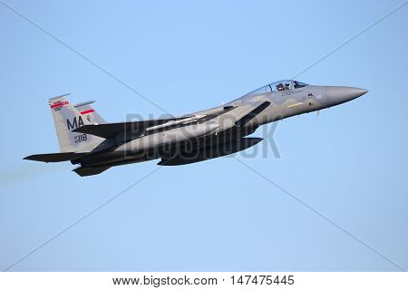 LEEUWARDEN NETHERLANDS - APR 11 2016: Massachusetts Air National Guard F-15C Eagle take off. The ANG is in Europe for a 6-month deployment in support of Operation Atlantic Resolve.