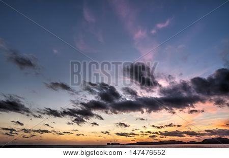 Capo Caccia under a purple sky at sunset Sardinia