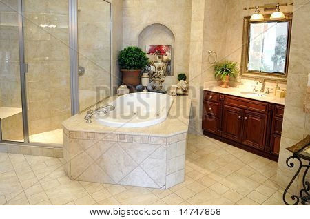 Modern tiled bathroom with glass shower stall