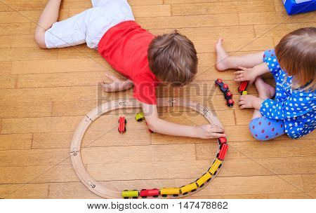 kids playing with railroad and trains indoor, kids playtime and learning