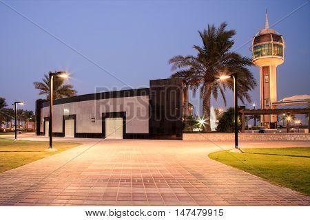 HIDD, BAHRAIN - SEPTEMBER 10, 2016: Night shot of a beautiful building and the coffee house tower in Prince Khalifa Bin Salman Park
